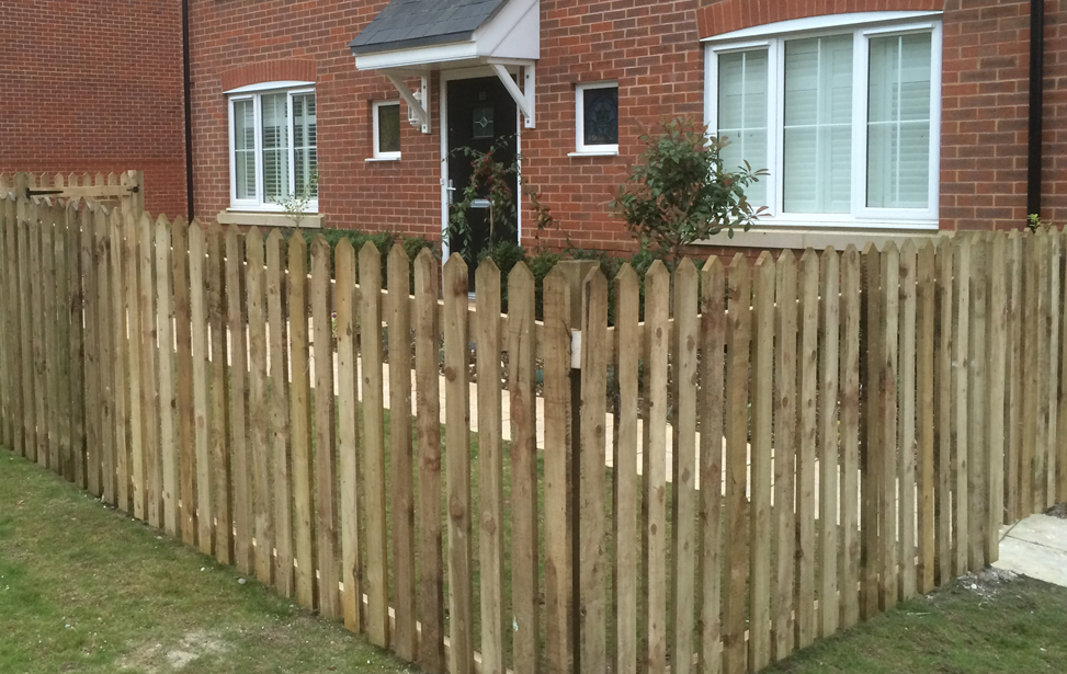 Custom built fence in front garden